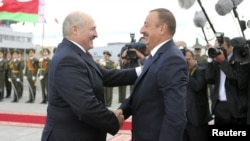 Belarusian President Alyaksandr Lukashenka (left) and his Azerbaijani counterpart, Ilham Aliyev, are both taken to task by the EU for the lack of human rights and press freedoms. (file photo)