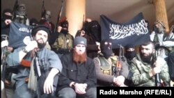 عناصر تنظيمات مسلحة تقاتل الحكومة السورية(من الارشيف)