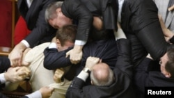 Deputies scuffle during a session of parliament in Kyiv in 2010, one of the many instances of political discourse that have lowered the bar for language in Ukraine.