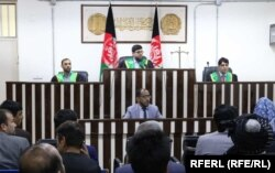 Afghan Supreme Court judge reads the decision in the case on May 26.