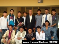 Anwari poses with some of his students at the Abdul Ali Mustaghni High School in Kabul.