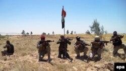 Pjesëtarë të forcave të sigurisë së Irakut në rrethinën e qytetit Baixhi