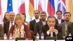 Iran's Deputy Foreign Minister Abbas Araghchi meeting European Union foreign affairs official Helga Schmid in Vienna on June 28, 2019.