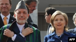 Afghan President Hamid Karzai (left) and U.S. Secretary of State Hillary Clinton (file photo)