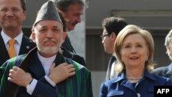 Afghan President Hamid Karzai (left) and U.S. Secretary of State Hillary Clinton (file photo)