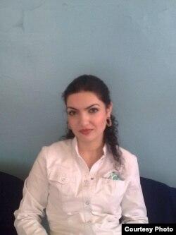 Amina Gunasheva, the wife of anesthesiologist Marat Gunashev, whom she hasn't seen since his jailing