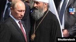 Президент Росії Володимир Путін та митрополит УПЦ (МП) Онуфрій. Архівне фото