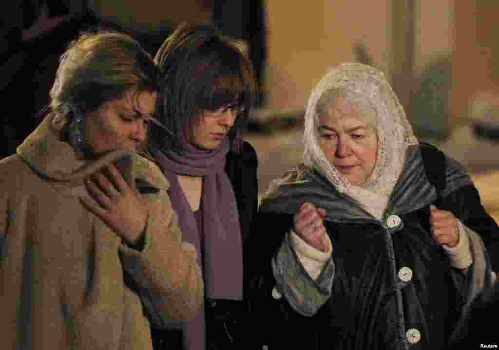 The former CEO's mother, Marina Khodorkovskaya (right), his wife Inna (left), and his daughter Anastasia walk out after a court hearing in Moscow on December 30, 2010. A judge sentenced Khodorkovsky to additional prison time on new charges of financial crimes.