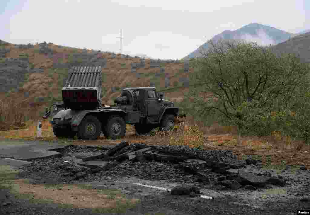 A multiple-rocket launcher belonging to ethnic Armenian forces sits on the road near Shushi/Susa.
