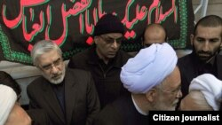 Opposition leaders Mir Hossein Musavi (left) and Mehdi Karrubi (with glasses and white turban) at a funeral procession for Grand Ayatollah Hossein Ali Montazeri in Qom in December.