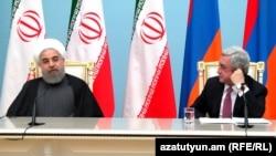 Президент Ирана Хасан Рухани и президент Армении Серж Саргсян во время брифинга с журналистами в Ереване. 21 декабря 2016 г.