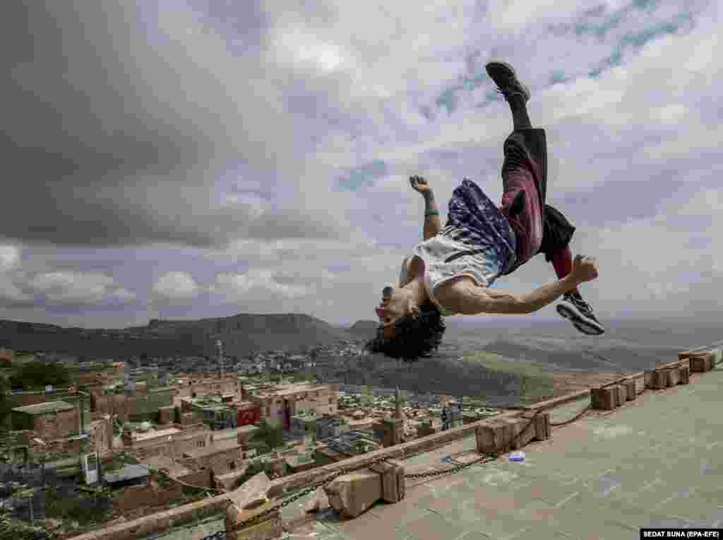 A participant makes a move during the Freerunning and Parkour World Series in old city of Mardin in eastern Turkey on May 13. (EPA-EFE/Sedat Suna)