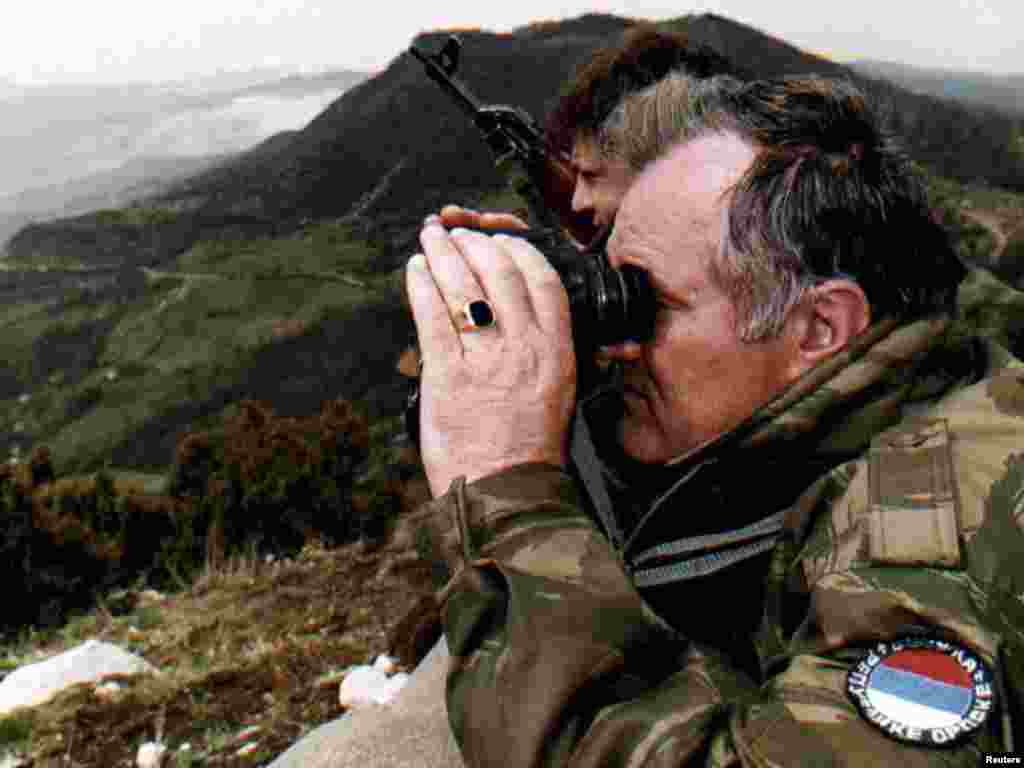 Mladic monitors a battle against Muslim forces from atop a hill some 4 km from the center of the eastern Bosnian city of Gorazde on April 16, 1994.