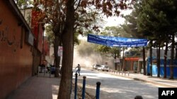 Afghanistan -- Smoke rises from buildings during an on-going attack in Kabul city center, 13Sep2011