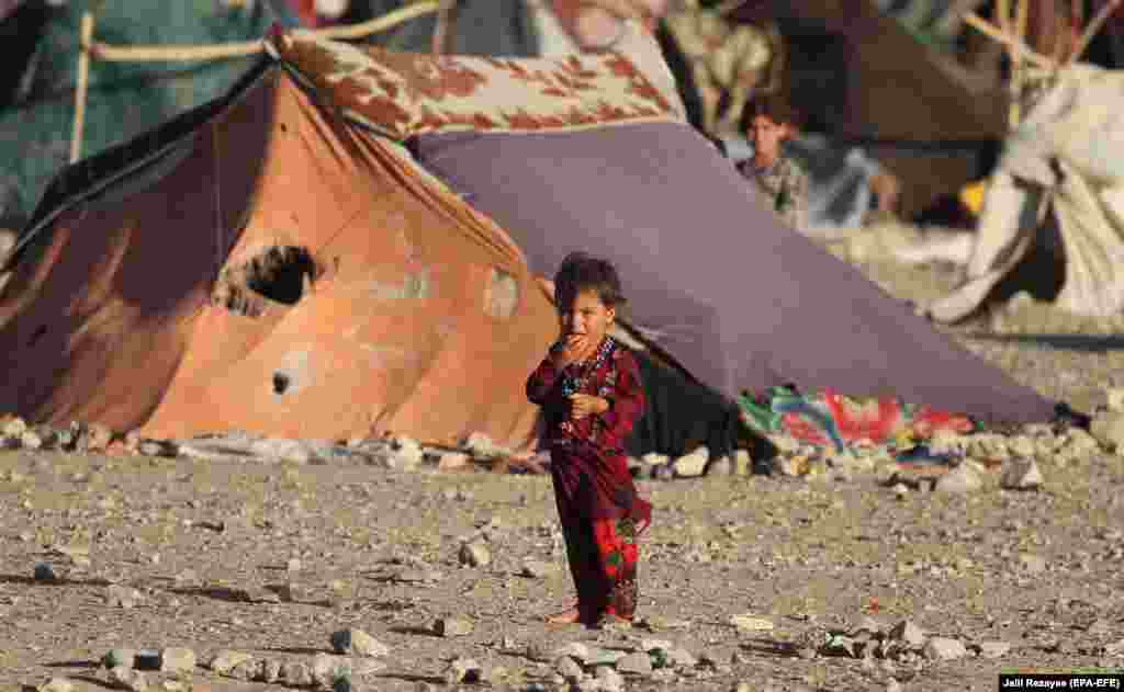 An internally displaced Afghan child is photographed near a temporary shelter in Herat. (epa-EFE/Jalil Rezayee)