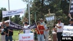 Demonstrators In Bishkek protest against OSCE police deployment In southern Kyrgyzstan on July 26.