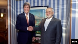 Norway -- US Secretary of State John Kerry (L) meets with Iranian Foreign Minister Javad Zarif at the Radisson Blu Hotel in Oslo, June 15, 2016