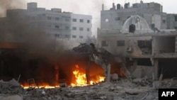 Smoke rises from a fire after Israeli air strikes in Gaza City on November 19.
