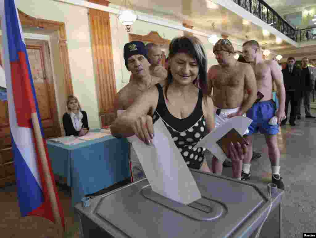 Member of the Polar Bear sports club casts their ballots in Barnaul, the capital of the Altai region.