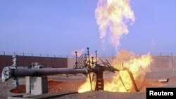 A gas pipeline in north Sinai carrying gas from Egypt to Israel in flames following an attack by an armed gang.