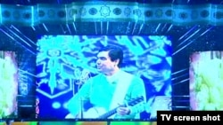 Turkmen President Gurbanguly Berdymukhammedov performs on his birthday in Ashgabat on June 29.