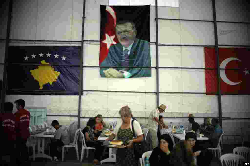 The Turkish flag and a picture of Turkish Prime Minister Recep Tayyip Erdogan hang on one side of the tent. Turkey is one of the main sponsors of the free dinner program.