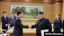 Встреча лидера Северной Кореи Ким Чен Ына с делегацией из Южной Кореи. Пхеньян, 6 марта 2018 года.