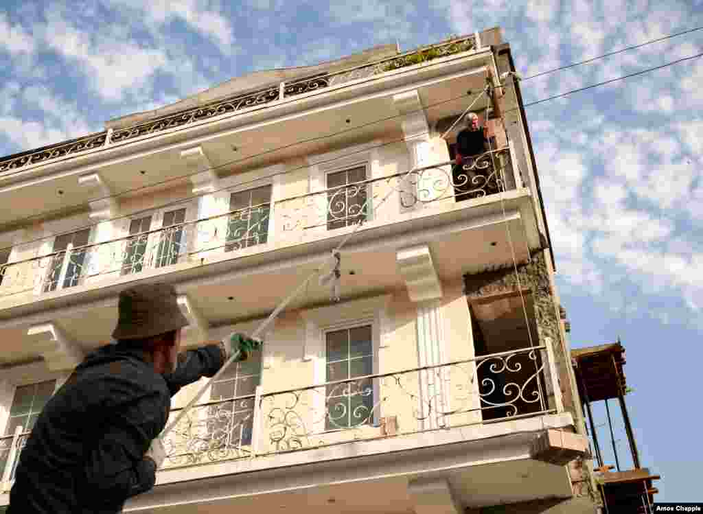 Laborers restore a building due to open as a hotel next year. Current laws in the territory forbid foreign citizens from buying property, but the Abkhaz government might open its markets.