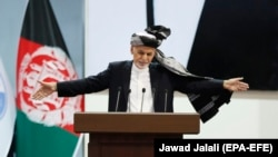 Afghan President Ashraf Ghani reacts during the closing ceremony of the government's Loya Jirga in Kabul on May 3.