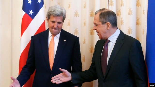 Russian Foreign Minister Sergei Lavrov (right) welcomes U.S. Secretary of State John Kerry prior to their talks in Moscow on March 24.
