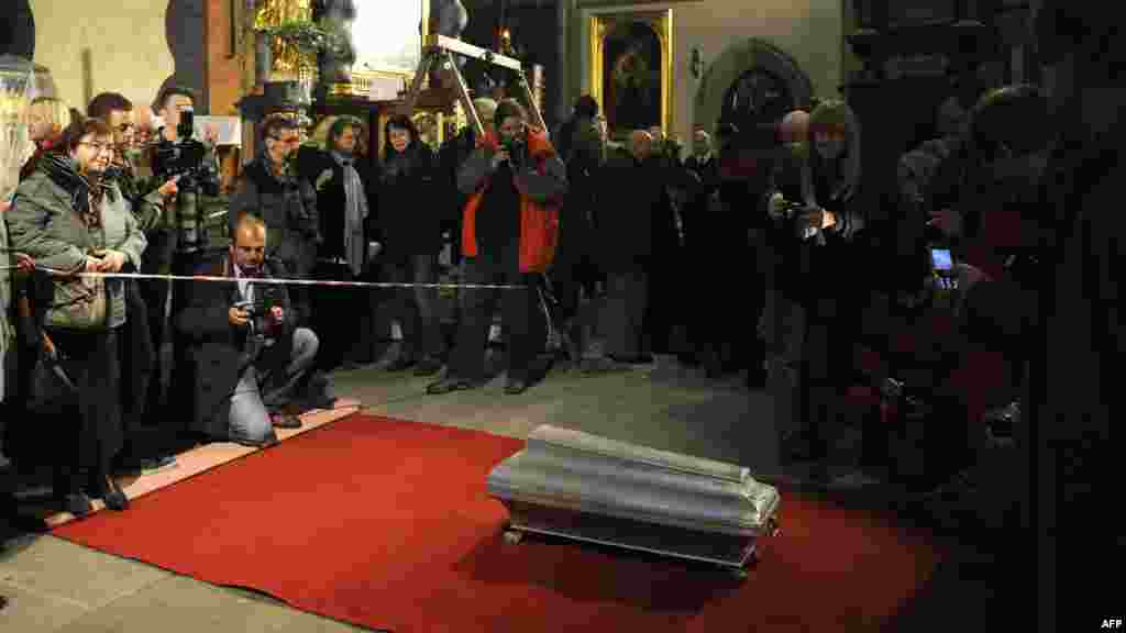 "The coffin of 16th-century Danish astronomer Tycho Brahe lies on a red carpet after archaeologists lifted it from his grave at the Church of Our Lady in Prague. Brahe died suddenly in 1601 at the age of 54 of what was believed to be a bladder infection. But some speculated that he may have been poisoned with mercury, possibly at the hands of a king or a rival astronomer. Danish scientists took samples from Brahe's body. They said on November 15 that ""mercury concentrations were not sufficiently high"" to cause the death. Brahe is credited with celestial observations which helped lay the groundwork for modern astronomy. (AFP/Michal Cizek)"