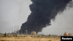 Smoke rises from the oil refinery in Baiji on October 14.