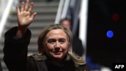 U.S. Secretary of State Hillary Clinton waves upon her arrival in Vilnius for an OSCE meeting.