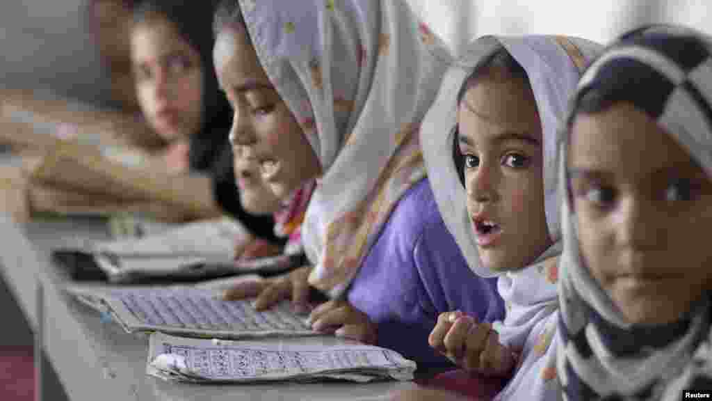 Girls recite verses from the Koran at a madrasah in Islamabad on July 27. (REUTERS/Rebecca Conway)