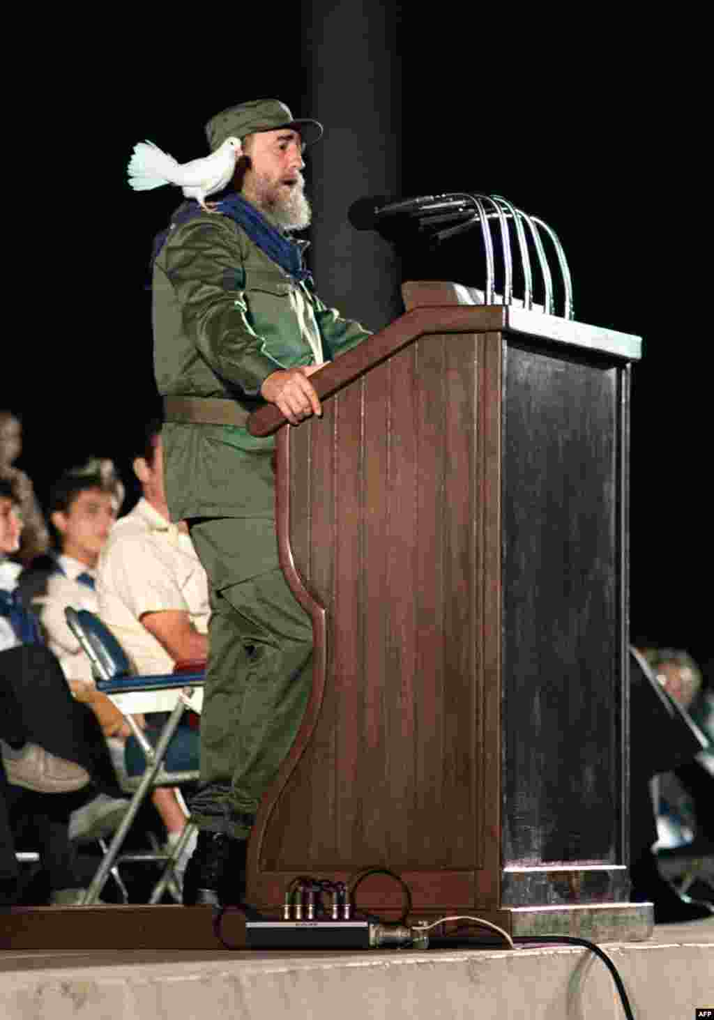 A dove rests on Castro's shoulders as he addresses Cuban youth in 1989 during celebrations marking the 30th anniversary of the country's communist revolution.