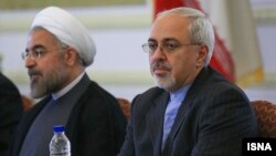 New Iranian President Hassan Rohani (left) and Iranian Foreign Minister Mohammad Javad Zarif
