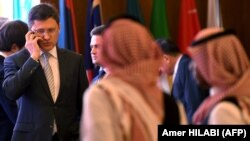 Russian Energy Minister Alexander Novak (L) attends a meeting of OPEC and non-OPEC members to assess compliance with production cuts and to discuss potential long-term cooperation, in the Saudi Red Sea resort of Jeddah on April 20, 2018.
