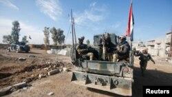 Իրաքցի զինծառայողները Մոսուլի թաղամասերից մեկում ԻՊ զինյալների հետ մարտերի ժամանակ, 22-ը դեկտեմբերի, 2016թ․