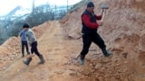Uneasy Riders: Kyrgyz Villagers Build Own Road To Avoid Deadly Route video grab