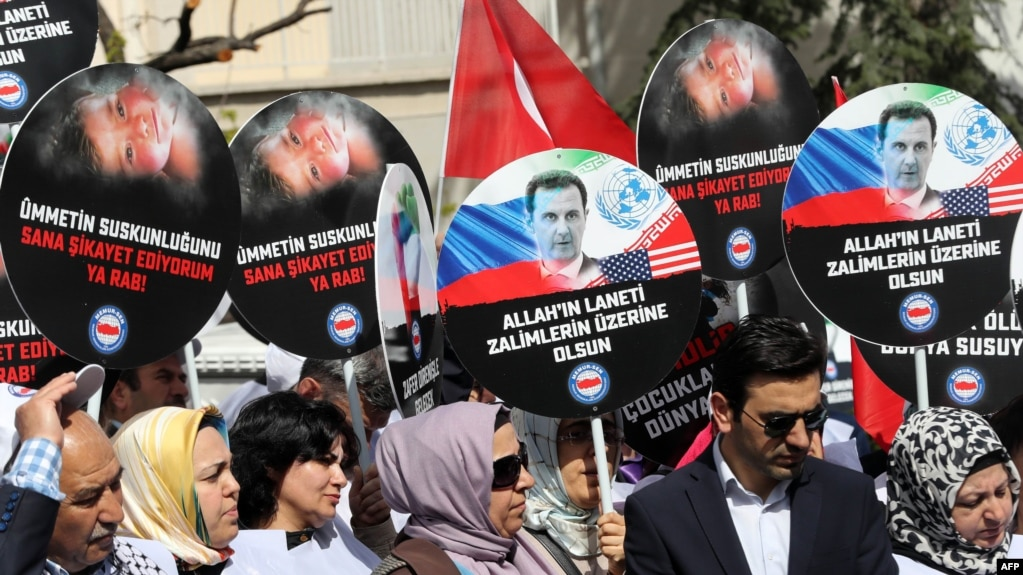 People protest against Russia for its alleged role in a chemical attack in the Syrian province of Idlib, in front of the Russian Embassy, in Ankara, on April 7.