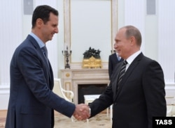 A file photo of Russian President Vladimir Putin and his Syrian counterpart Bashar al-Assad.