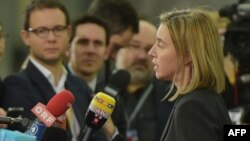 EU foreign policy chief Federica Mogherini talks to journalists prior to the foreign ministers' meeting in Riga.