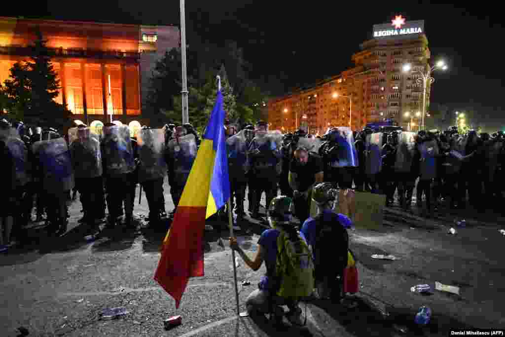 "Police denied using excessive force, while Romania's interior minister said riot police had intervened against ""hooligans who had attacked the state's authority."""