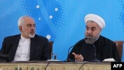 Міністр закордонних справ Ірану Мохаммад Джавад Заріф (л) і президент країни Хасан Роугані