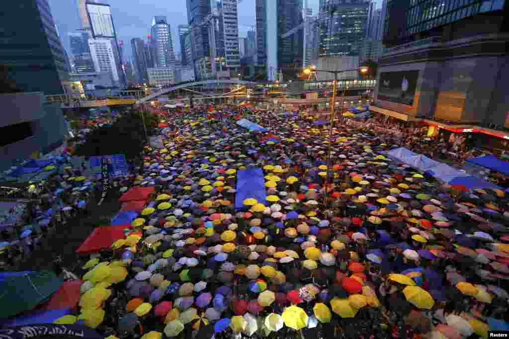 On October 28, Hong Kong protesters open their umbrellas -- symbols of the pro-democracy movement -- as they mark exactly one month since they took to the streets in the territory's financial district demanding political reform. (Reuters/Damir Sagolj)