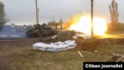Ukrainian Soldier's Video Shows Intense Fighting Around Donetsk (video grab)