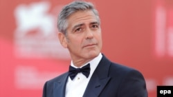 Italy -- US actor and director George Clooney arrives for the premiere of his movie 'The Ides of March' that opened the 68th Venice Film Festival, in Venice, 31Aug2011
