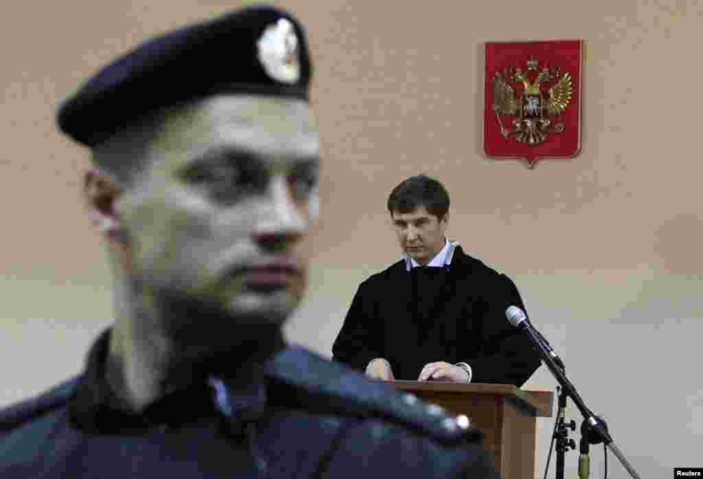 Judge Sergei Blinov reads the verdict during the hearing in Kirov.