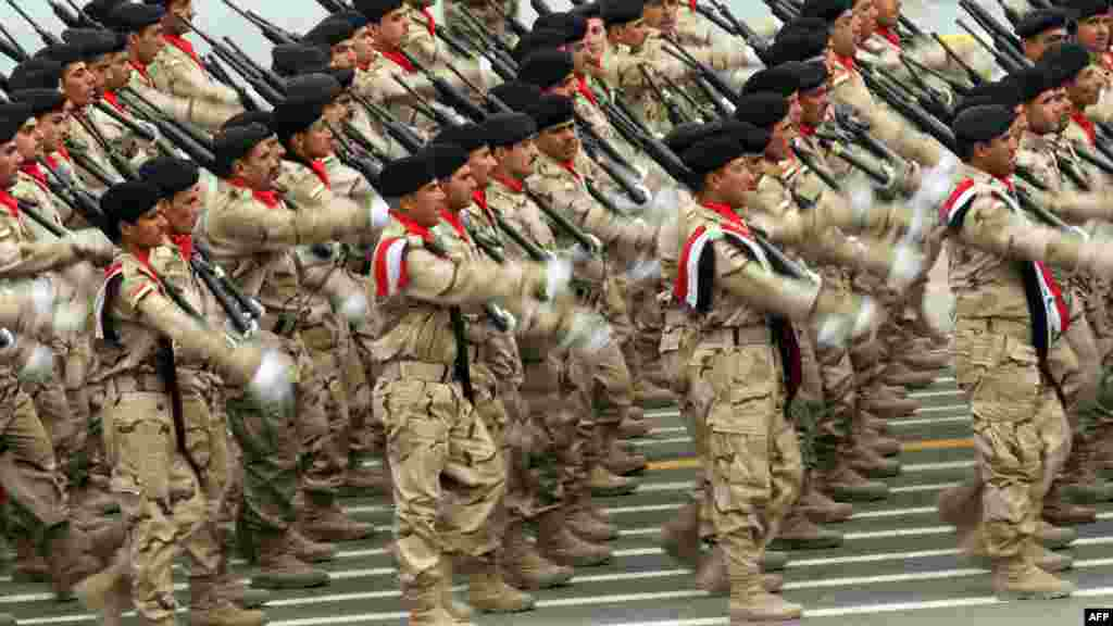 Army soldiers march to mark the 91st Army Day parade in Baghdad, Iraq. AFP PHOTO/ALI AL-SAADI