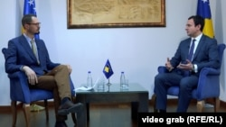 Kosovo's new prime minister Albin Kurti (right) made his remarks in an interview with RFE/RL's Balkan Service on February 7.